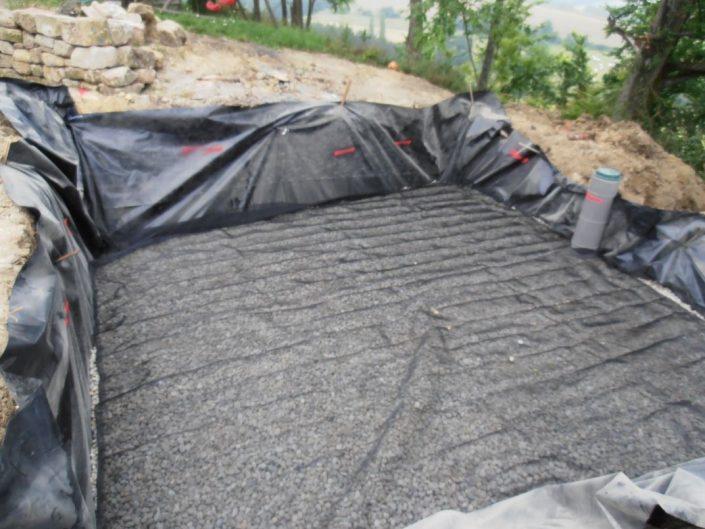 Pose du regard de collecte et du drainage de fond du filtre à sable